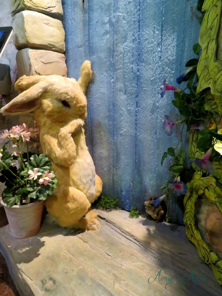 Model figure of Peter Rabbit without his blue jacket in Beatrix Potter World in Bowness-on-Windermere, The Lake District.