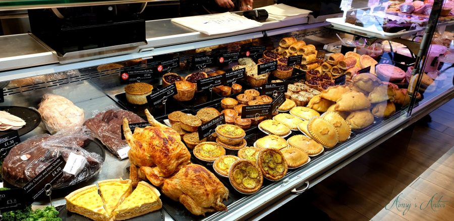 Counter inside Edward's of Conwy Butchers, showcasing various pies