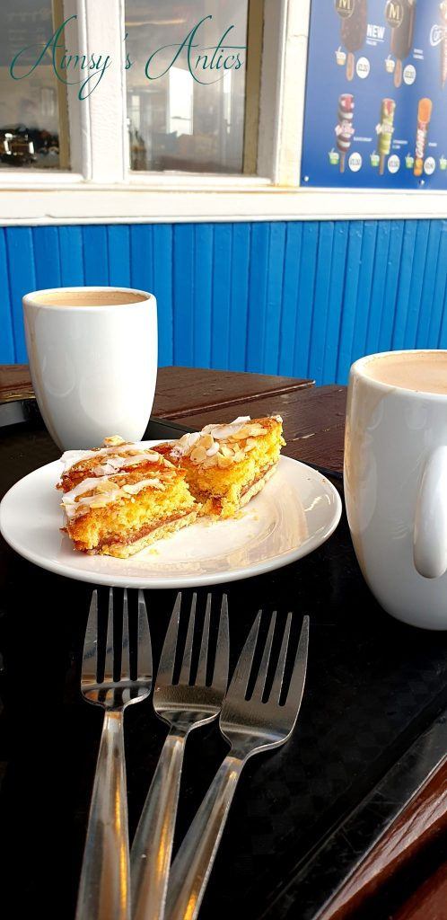 Two cups of coffee and bakewell tart on the Llandudno pier