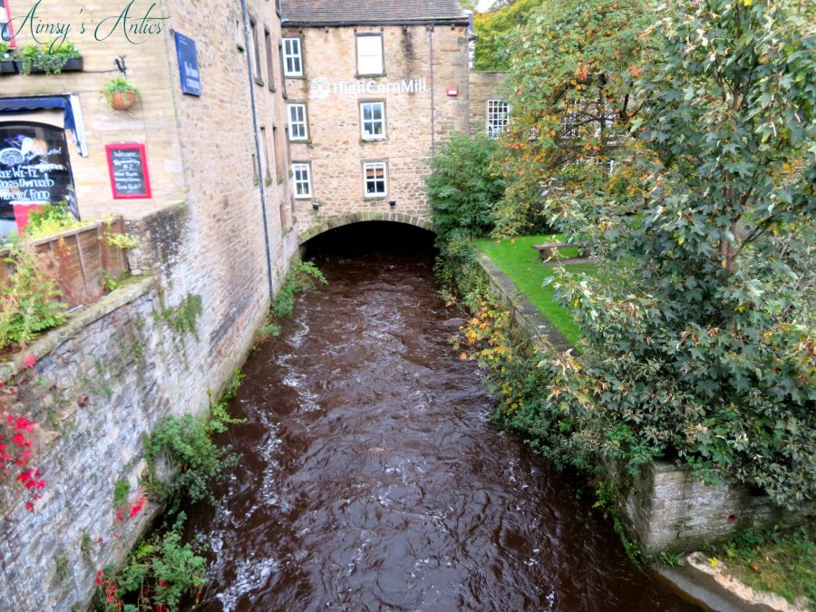 View of the fast flowing river through Skipton