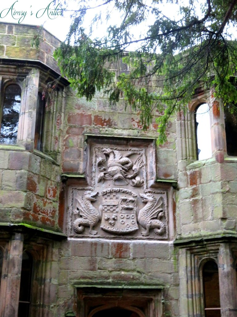 Emblem of a shield and dragons on the wall of Skipton Castle