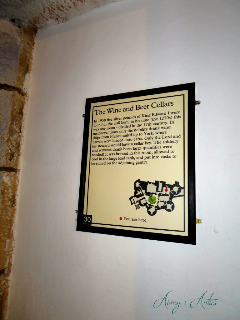 Information plaque detailing the wine and beer cellars at Skipton Castle.