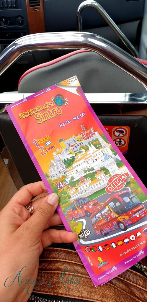 Hand holding a City Sightseeing Sintra map
