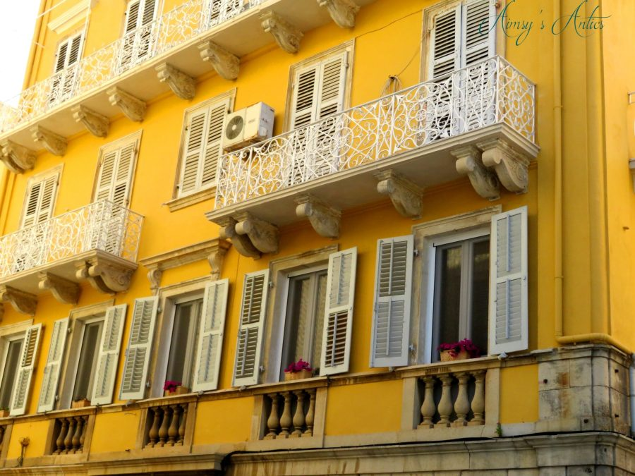 Yellow building with white railing balconies in Corfu Town