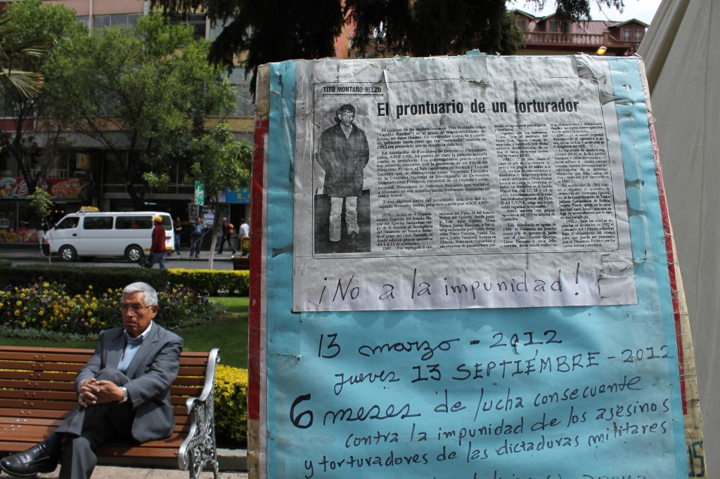 "Newspaper headline: ""The record of a torturer;"" Written note: ""No to impunity!  March 13, 2012 – Thursday, September 13, 2012: Six months of consecutive fight against impunity of murderers and tortures of the military dictatorships"""