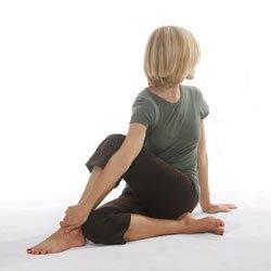 Hatha yoga practitioner warming up