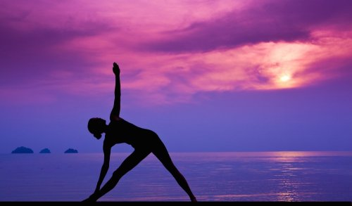 Practitioner warming up with sunset in the background