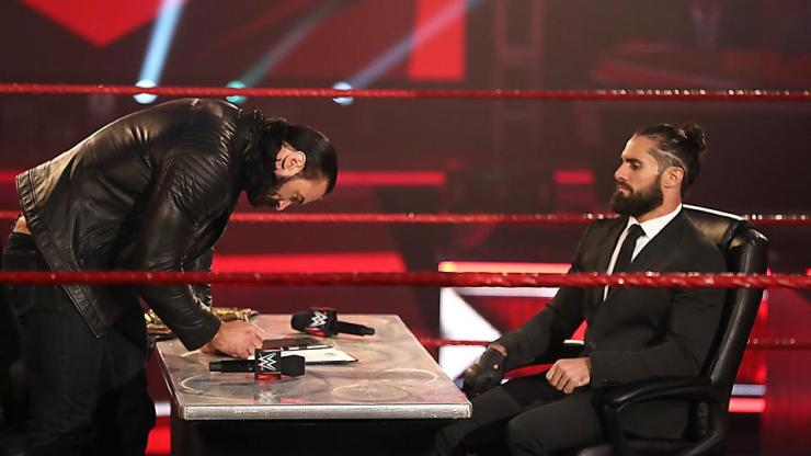 Contract signing between WWE Champion Drew McIntyre and challenger Seth Rollins