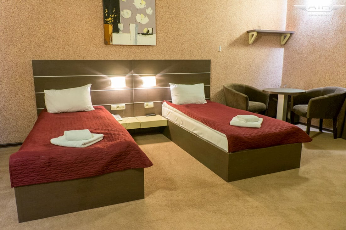 Two beds in motel photo