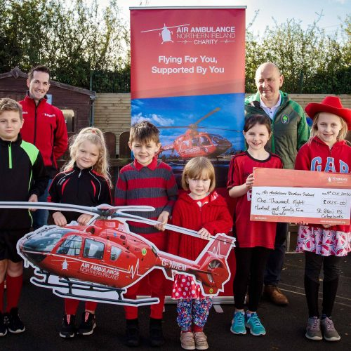 The pupils, staff and families of St Peter's P.S. Collegelands have raised £1825 for the Air Ambulance NI Charity following their 'Red Day' for the helicopter emergency medical service. Pictured are pupils from St Peter's along with principal Mr. Jim Mc Alinden and Damien McAnespie, Air Ambulance NI Fundraising Manager. A huge thank you to everyone who donated to this life-saving service.