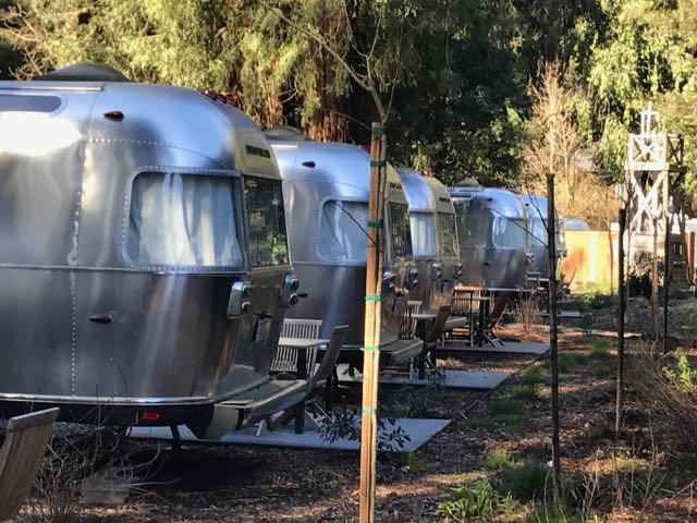 Row of Airstream hotel camper trailers