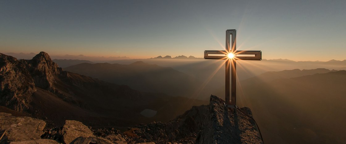 Cross with sun piercing through