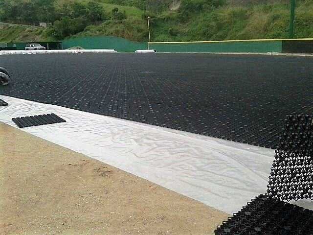 Synthetic grass, Accelerated drainage system, artificial grass, LEED, turf, landscape, drainage, golf, artificial turf, fieldturf, field turf, synthetic turf, athletic field, green roof, softball, baseball, football, soccer, futsal, lacrosse, field hockey, bocce, tee boxes, sub-surface, sports field, forever lawn, synlawn, USGA, rooftop, shockpad, elayer, gmax, hic, foreverlawn, astro turf, prograss, newgrass, geocell, geo cell, geogrid, geo grid, shock pad, usgbc, asla, aia, green building, batting cages, batting cage, bullpen, bullpens, airdrain geocell, Artificial Turf, Soccer, Baseball, Super Bowl, NCAA, AirField Systems, Sports Field Drainage, Athletic Field Drainage, Baseball field Drainage, Football Field Drainage, Soccer field Drainage, Lacrosse field Drainage, turf performance field, airdrain, air drain, air grid, airgrid, paved court converted to turf
