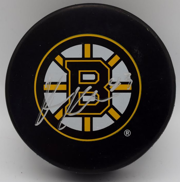 Boston Bruins Official Game Puck-Signed by Karson Kuhlman Image