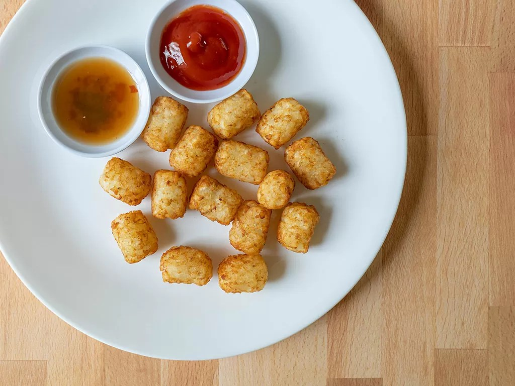 Air fried Kroger Tater Bites with ketchup and hot sauce