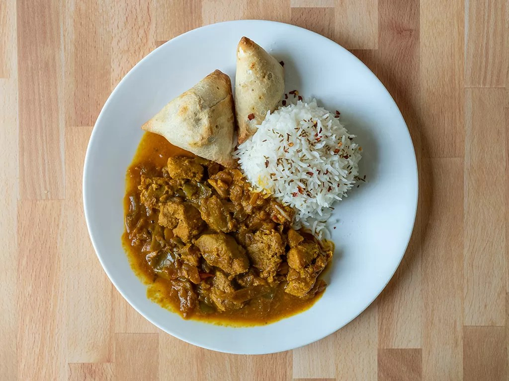 Air fried samosa with rice and curry