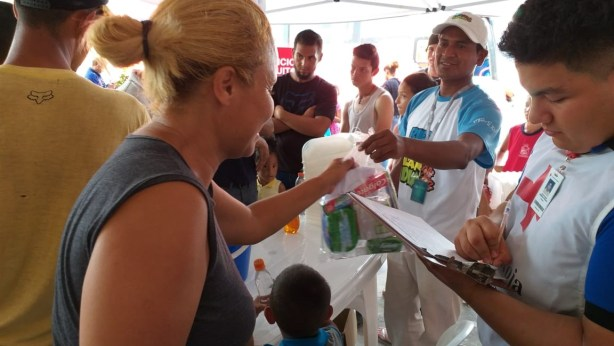 aid distribution for Venezuelan refugees in Ecuador.