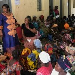 Women's activist Neema Namadu working with women in a health center in the DRC.
