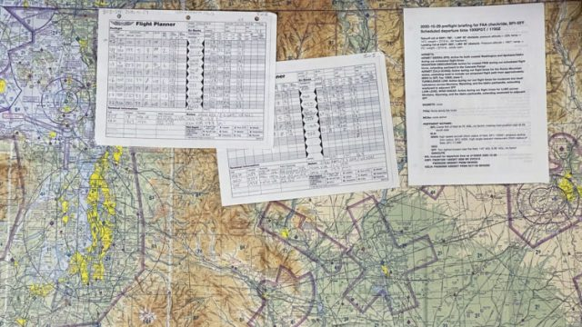 A Seattle sectional chart, the paper flight logs, and the first page of the briefing I wrote up for my checkride