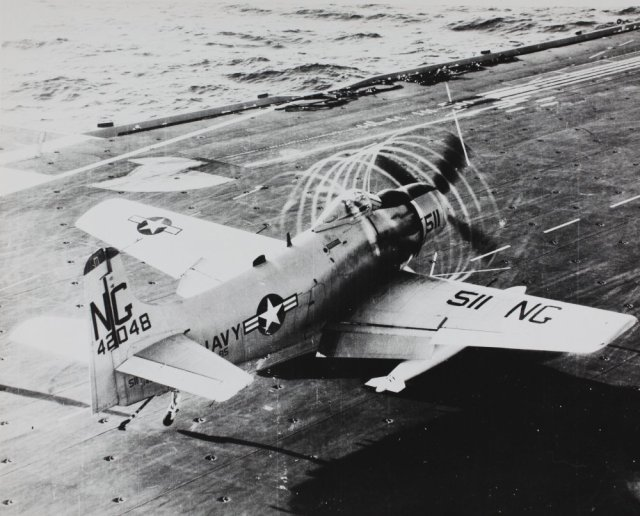 Douglas_A-1_Skyraider_with_prop_contrails_Stan_Abele_Collection_Image_(15173319177)