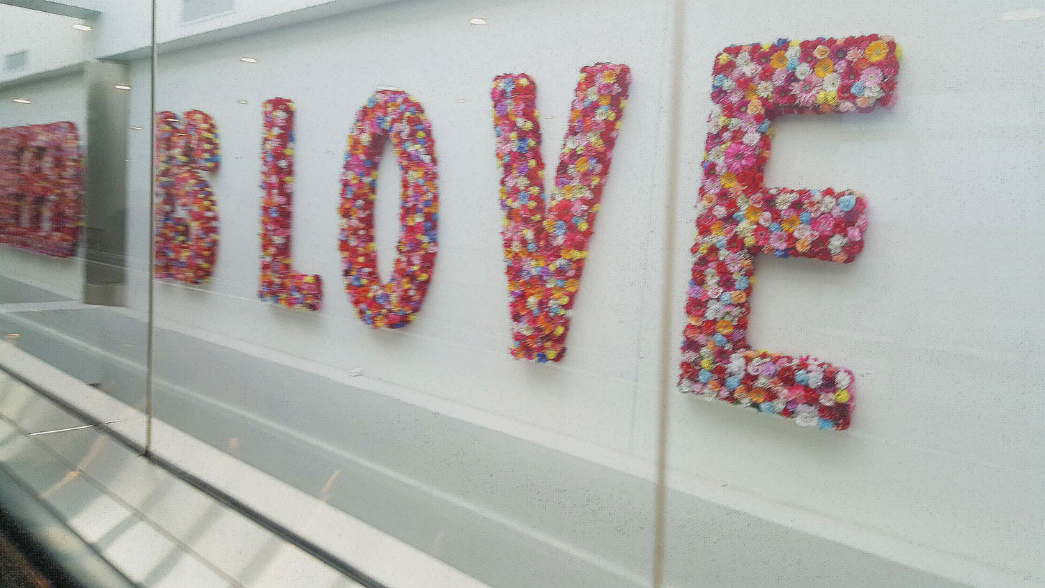 The word 'Love' spelled out in flowers