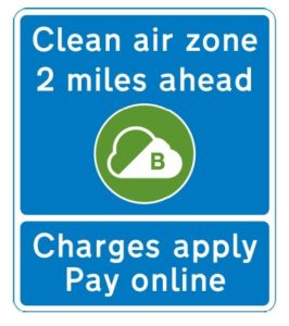 """Road sign graphic indicating """"Clean Air Zone 2 miles ahead - Charges Apply, Pay Online"""""""