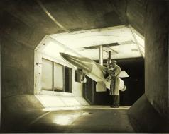 An F-111 scale model is readied for testing in the General Dynamics low speed wind tunnel. (Photo SDASM Cat # 10_0012033)