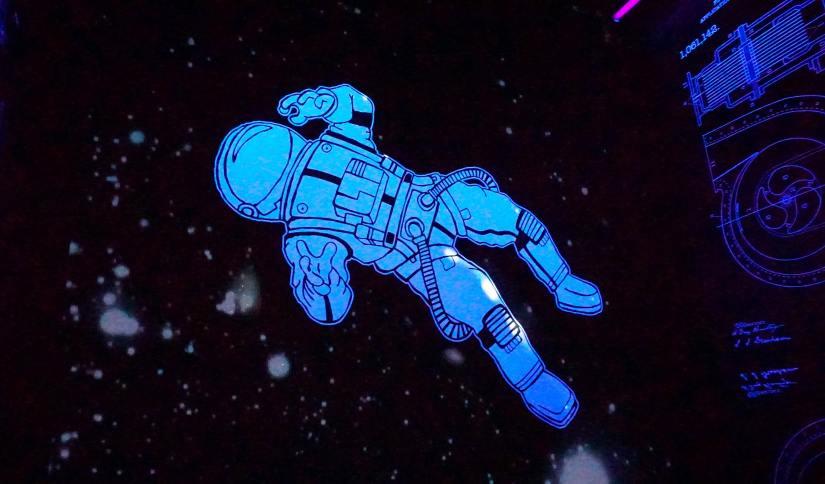Blue and white cartoon astronaut