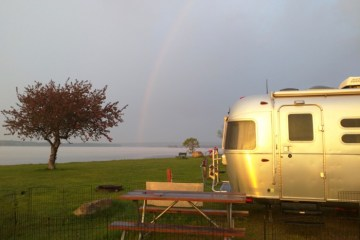 airstream rainbow by river