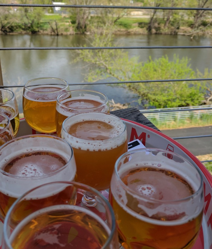tasting flight by the river at new belgium