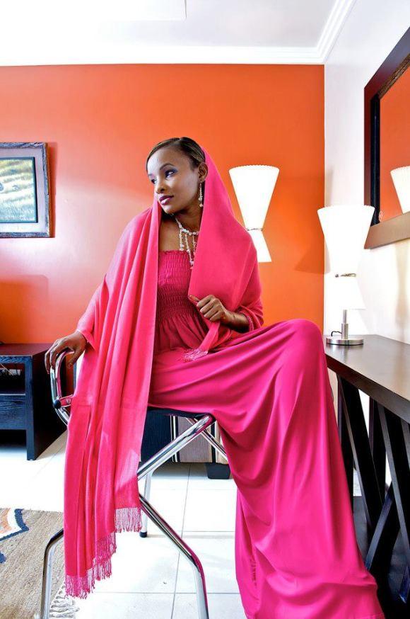 A Somali Kenyan woman looking elegant in pink Somali dress