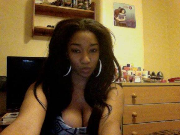 A banging African beauty from Nigeria, sitting in the office