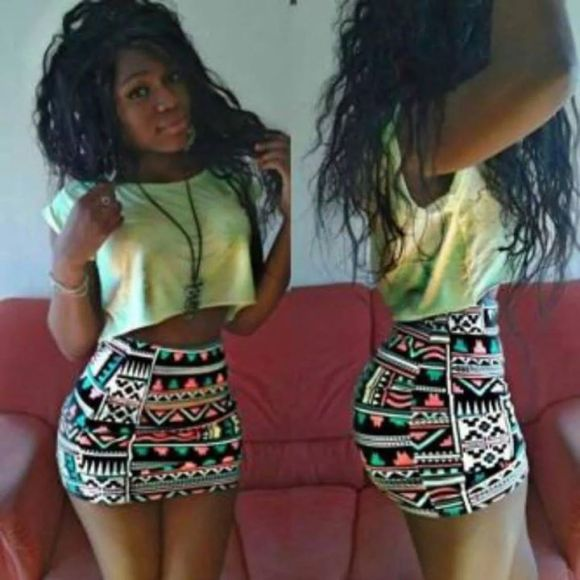 A Sexy Young Nigerian Female in Short African Mini Dress Showing Fine Belly
