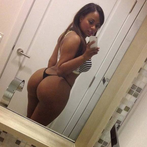 Sexy girl in G-string shows her backside