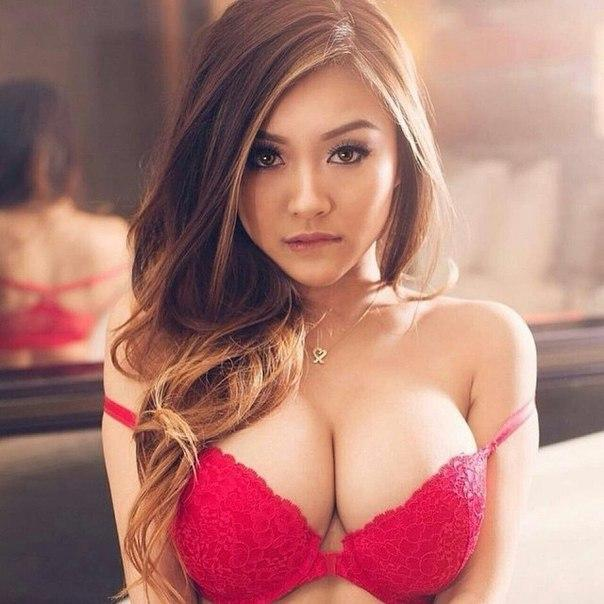 A pretty,cute and seductive Russian / Japanese woman looking hot as she unveils her big boobs