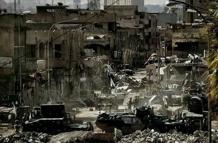 The aftermath of heavy shelling on Nabi Sheet, destroying the city's main market for handicraft and killing up to 16 people (via Mosul Ateka)