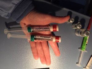 Look alike syringes labeled to alert provider.
