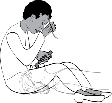 Illustration showing one technique to intubate a patient on the ground. Sitting to the right of a cardiac arrest victim during intubation allows the intubator to ergonomically lift the patient's head and see the glottis.