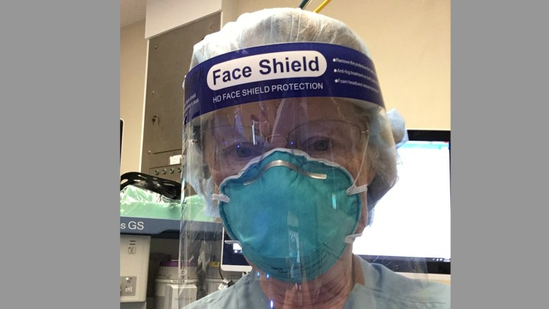 photo of the author Christine Whitten wearing PPE