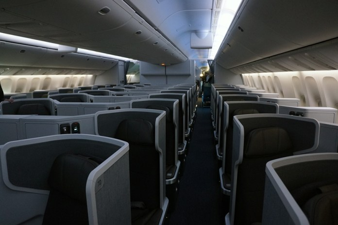 "The New American Sigma Business Class cabin is upgraded with an incredibly roomy configuration with fifty-two seats 75"" pitch and 26"" lie-flat seats in a 1-2-1 configuration. The seats are similar to those of Cathay Pacific and are a quantum leap improvement over the current 2-3-2 Business Class. American sacrificed capacity for a significantly upgraded passenger experience in Business as this class is the main driver for business travel and premium revenue. This cabin will be the similar to the new 777-200 Business Cabin as these aircraft will no longer have First Class Flagship Suites. (Credits: Chris Sloan)"