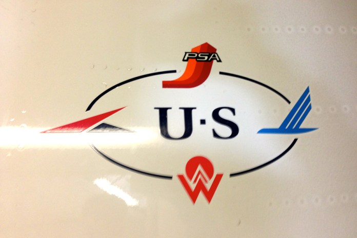 This logo is located at the entrance of every US Airways plane. (Credits: Author)