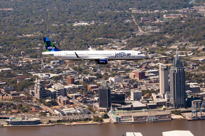 The first Airbus built in the U.S.A. overflying the city of Mobile. (Credits: Airbus)