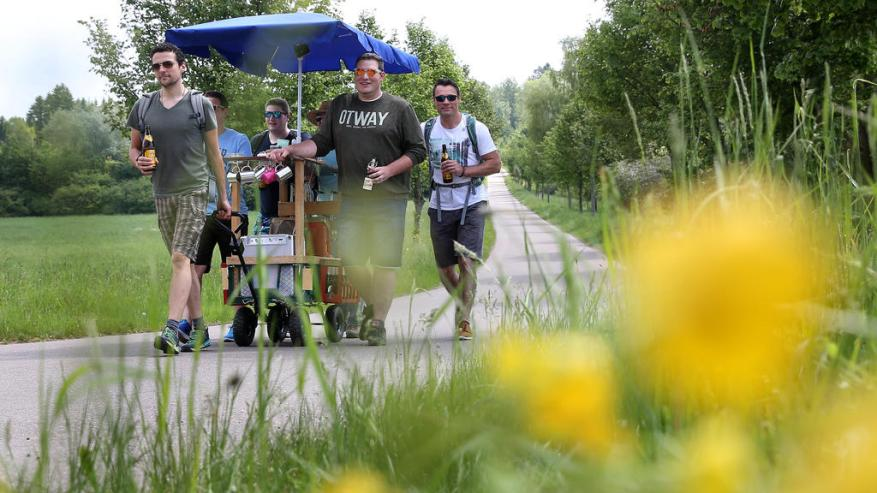 On May 25, 2017, a group of men was on their father's day tour with a handcart and a parasol near Erisdorf (Baden-Württemberg). Photo: Thomas Warnack / dpa | Use worldwide