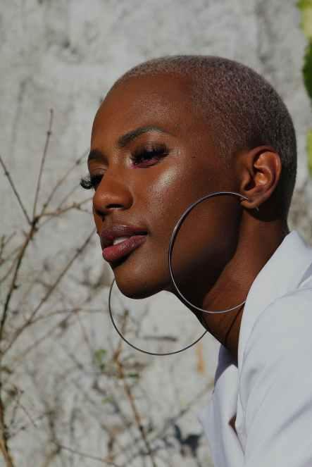 portrait of a woman wearing silver colored hoop earrings