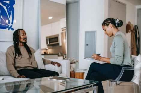 black man speaking with psychologist