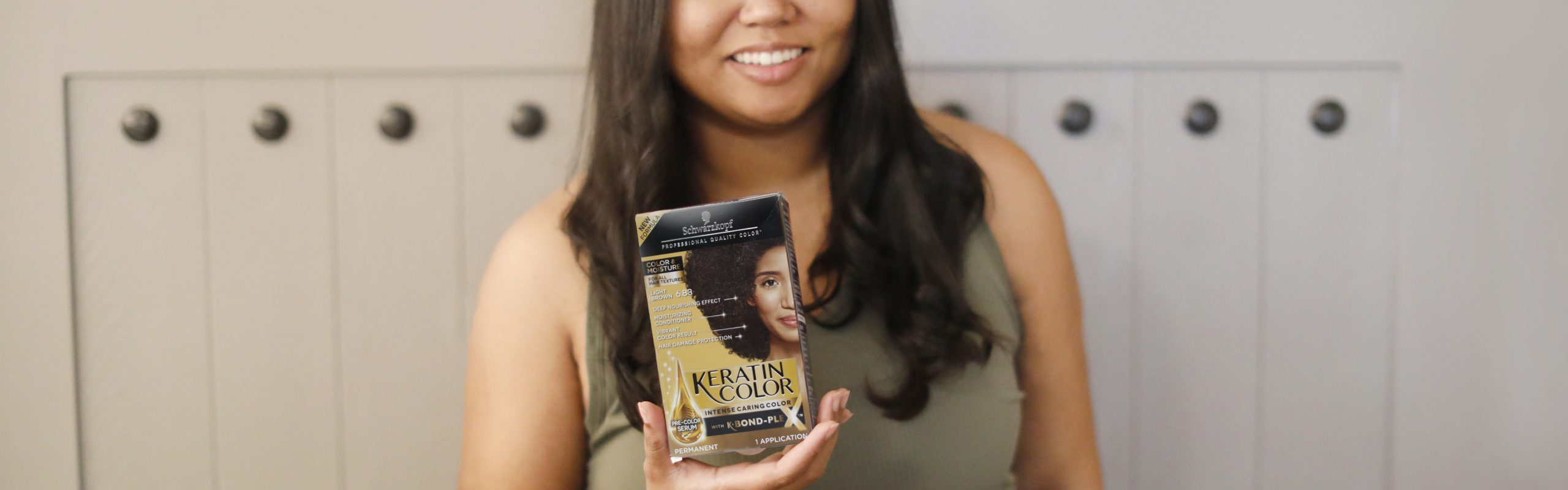 woman holding keratin color box