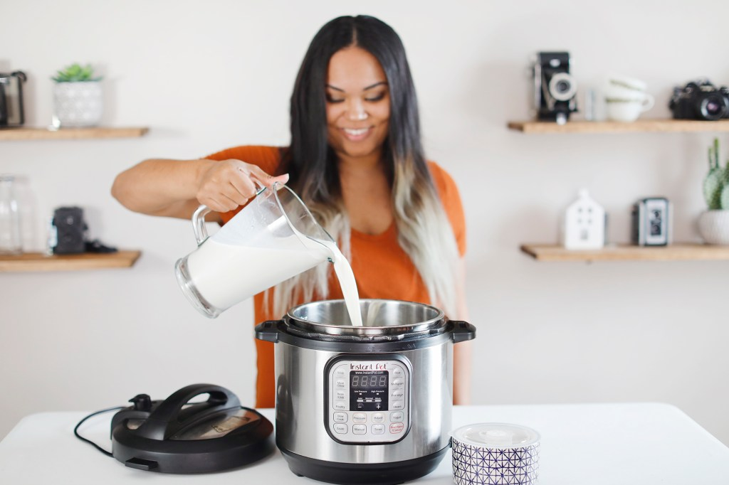 Ai Travels Blog pouring milk into Instant Pot