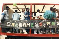 Photograph of young men on a float, with banner saying Greenheys Massive