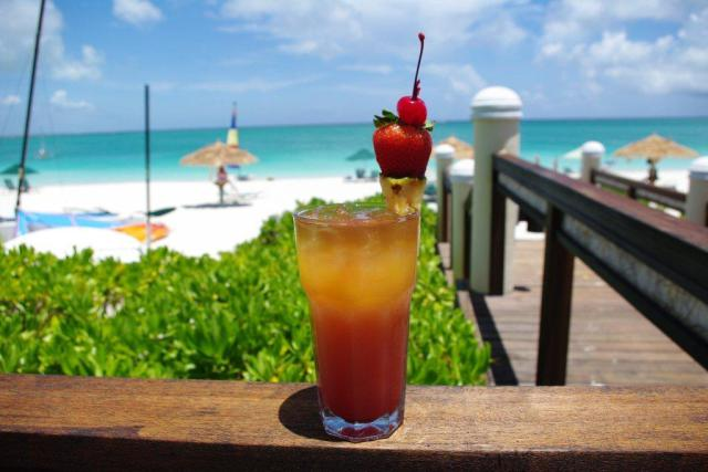a glass of jamaican rum punch on the beach