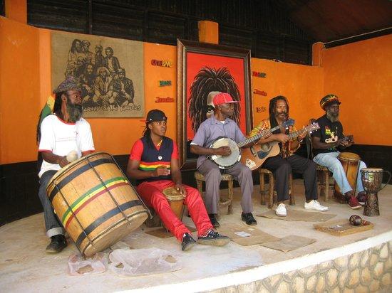 musicians singing at the Bob Marley Museum
